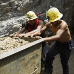 Miners and rescue workers take part in the rescue operation of nine miners trapped at Cabeza de Negro gold-and-copper mine in Ica